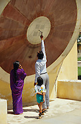 A family visiting Jantar Mantar observartory built by Raja Jay Singh.