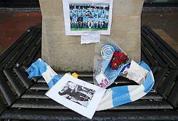 A scarf and pictures featuring the late Cyrille Regis before Coventry City's and Swindon Town's match at the Ricoh Arena