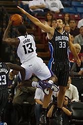 Jan 8, 2012; Sacramento, CA, USA; Sacramento Kings point guard Tyreke Evans (13) shoots past Orlando Magic power forward Ryan Anderson (33) during the first quarter at Power Balance Pavilion. Mandatory Credit: Jason O. Watson-US PRESSWIRE