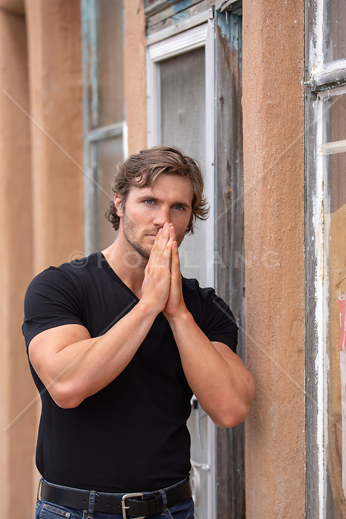 hot guy with hands up to his face