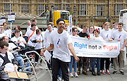 A Right not a Fight <br /> campaign activists outside Parliament, Westminster, London, Great Britain <br /> 16th June 2016 <br /> <br /> This campaign is petitioning Edward Timpson MP Minister of State for Children and Families to ensure that everyone who has a statement of special educational needs or an Education, Health &amp; Care plan has a named careers adviser with expertise and knowledge to provide impartial advice and guidance from year 9. <br /> <br /> More than 100 young people from across the UK are demonstrating today. <br /> <br /> Making a speech is 21 year old Alex Johnson from The National Star College Gloucestershire <br /> <br /> Photograph by Elliott Franks <br /> Image licensed to Elliott Franks Photography Services