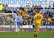 Fulham forward Moussa Dembele wins a header during the Sky Bet Championship match between Reading and Fulham at the Madejski Stadium, Reading, England on 5 March 2016. Photo by Adam Rivers.