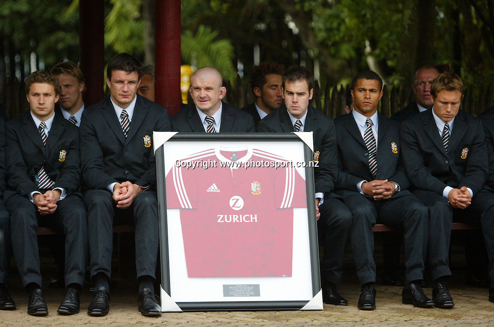 The Lions sit with their gift at the Taurangawaewae Marae in Ngaruawahia, New Zealand on Saturday June 11, 2005. The Lions play the NZ Maori team tonight in Hamilton. Photo: Hannah Johnston/PHOTOSPORT