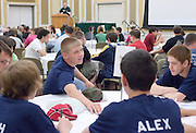 Adam Hanson (center) talks with his teammates as the Russ College of Engineering and Technology research fair/engineering day begins in the Baker Center ballroom on Thursday, 5/3/07.