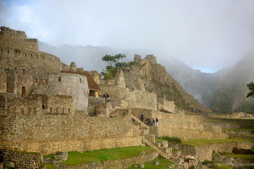 South America, Peru, Machu PIcchu. The ancient citadel of Machu Picchu cloaked in mist.