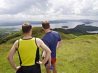 Two men standing on hillside