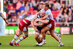 Joe Latta of Bristol Bears is tackled by Jamie Gibson of Northampton Saints and Dylan Hartley of Northampton Saints ,- Mandatory by-line: Ryan Hiscott/JMP - 29/09/2018 - RUGBY - Ashton Gate Stadium - Bristol, England - Bristol Bears v Northampton Saints - Gallagher Premiership Rugby