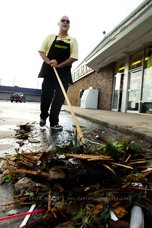 May 24, 2011- Randy, a employee of the Dollar General in Joplin, Missouri sweeps debris off the parking lot after a Tornado came through the town on Sunday, May 22, 2011. Credit: David Welker / TurfImages.com.