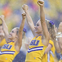 Sep 21, 2013; Baton Rouge, LA, USA; LSU Tigers cheerleaders perform in the rain during the first half of a game against the Auburn Tigers at Tiger Stadium. Mandatory Credit: Derick E. Hingle-USA TODAY Sports