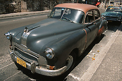 Old American car parked on a Havana street,