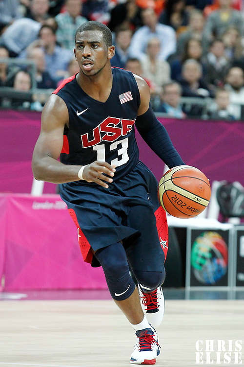 31 July 2012: USA Chris Paul dribbles during 110-63 Team USA victory over Team Tunisia, during the men's basketball preliminary, at the Basketball Arena, in London, Great Britain.