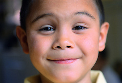 Close up portrait of young boy smiling,