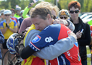 LOWER MAKEFIELD, PA -  SEPTEMBER 14:  Michael Wuerger, of Hatboro, Pennsylvania is hugged by Nancy Madden, whose husband Dan recently passed away  during the Ride 2 Recovery Minutemen Challenge September 14, 2013 at the Garden of Reflection in Lower Makefield, Pennsylvania. Injured active duty and retired military members are riding hand cycles, recumbents, tandems and road bikes from Lexington, Mass., to Philadelphia. (Photo by William Thomas Cain/Cain Images)