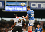 Matt Clarke beats Darren Bent to the ball during the Capital One Cup match between Portsmouth and Derby County at Fratton Park, Portsmouth, England on 12 August 2015. Photo by Adam Rivers.