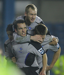 LONDON, ENGLAND - SATURDAY, JANUARY 7th, 2006: Everton's Leon Osman celebrates scoring the equaliser with team-mates James Beattie and Tony Hibbert during the FA Cup 3rd Round match at the New Den. (Pic by Chris Brunskill/Propaganda)