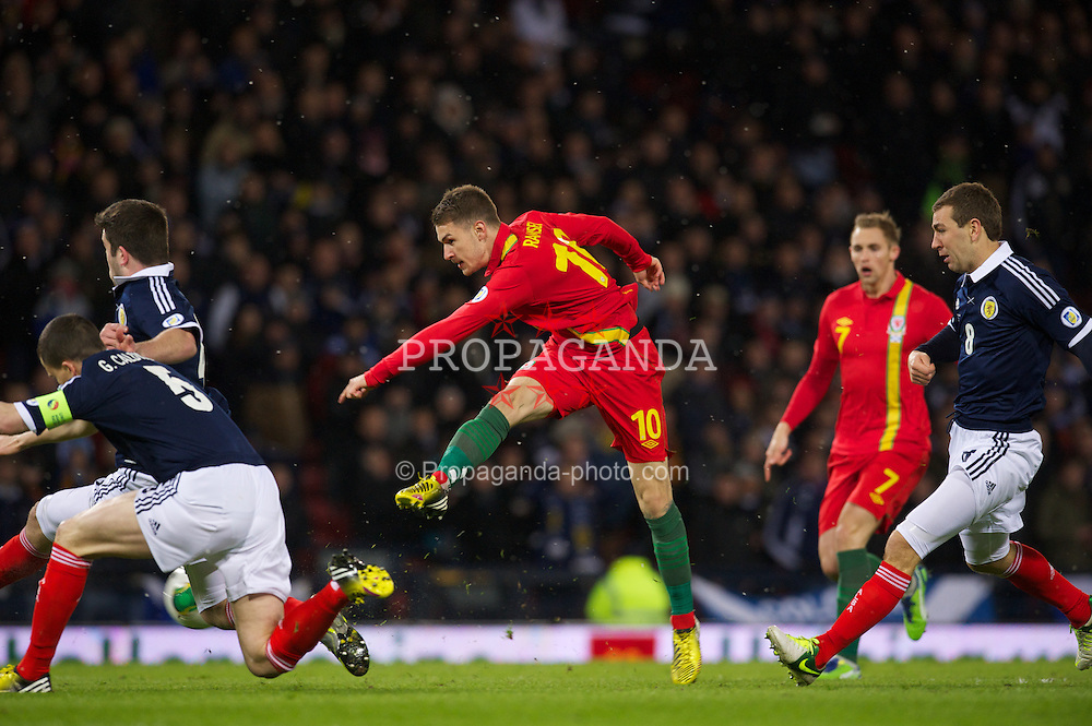 GLASGOW, SCOTLAND - Friday, March 22, 2013: Wales' Aaron Ramsey in action against Scotland during the 2014 FIFA World Cup Brazil Qualifying Group A match at Hampden Park. (Pic by David Rawcliffe/Propaganda)