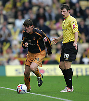 Photo: Lee Earle.<br /> Watford v Wolverhampton Wanderers. Coca Cola Championship. 29/10/2005. Darren Anderton (L) sprints away from Watford's Darius Henderson.