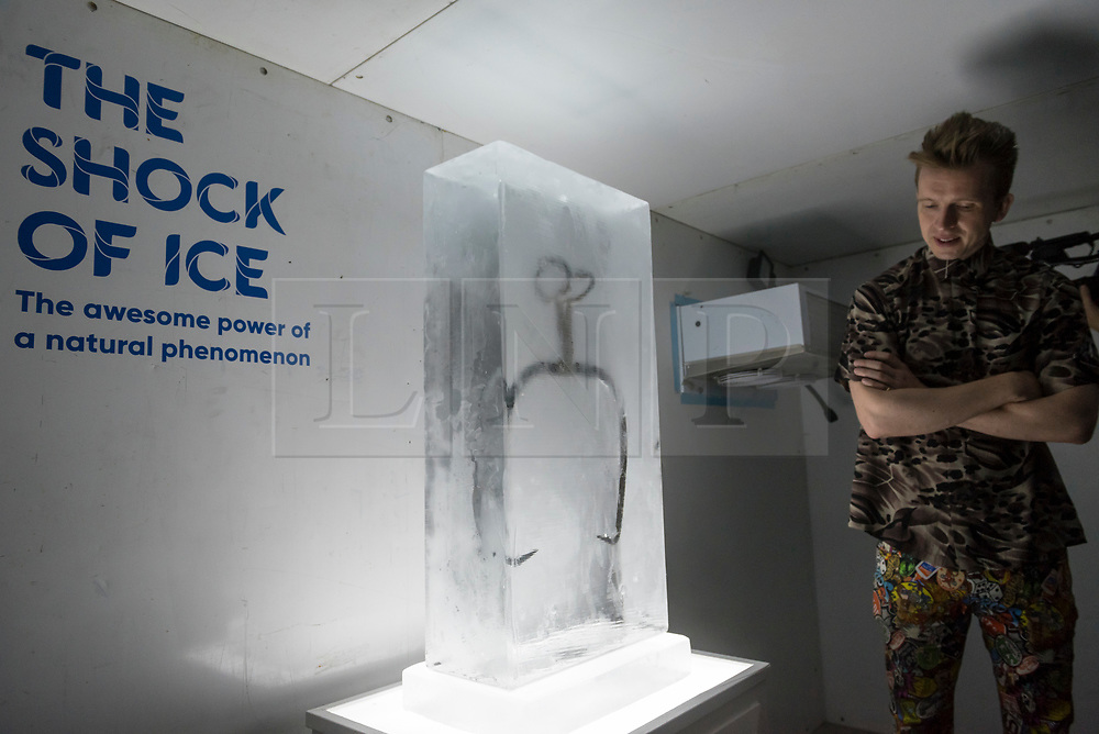 "© Licensed to London News Pictures. 03/07/2018. LONDON, UK. An Ice Hook (or Ice Dog) , circa 1910, presented encased in a block of ice, at a preview of ""SCOOP: A Wonderful Ice Cream World"", the first official exhibition of the British Museum of Food.  The exhibition presents items from the Robin and Caroline Weir Collection and explores the science and appeal of ice cream going back 400 years.  The exhibition takes place at the Gasholders near Granary Square in Kings Cross and runs 3 July to 30 September 2018.  Photo credit: Stephen Chung/LNP"