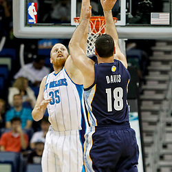 December 21, 2011; New Orleans, LA, USA; Memphis Grizzlies small forward Josh Davis (18) shoots over New Orleans Hornets center Chris Kaman (35)during the first quarter of a preseason game at the New Orleans Arena.  The Hornets defeated the Grizzlies 95-80. Mandatory Credit: Derick E. Hingle-US PRESSWIRE