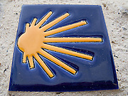 On a wall in Navarrenx this brightly coloured tile advertised the direction to Santiago de Compostela. All along the Way of Saint James there were similar symbolic signs to lead pilgrims to their destination.