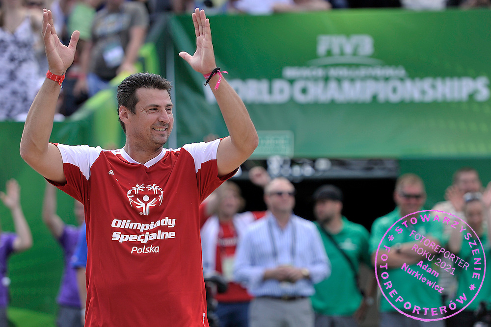 Wladimir Grbic of Serbia (L) celebrates a winning point while exhibition match of Special Olympics Poland during Day 7 of the FIVB World Championships on July 7, 2013 in Stare Jablonki, Poland. <br /> <br /> Poland, Stare Jablonki, July 07, 2013<br /> <br /> Picture also available in RAW (NEF) or TIFF format on special request.<br /> <br /> For editorial use only. Any commercial or promotional use requires permission.<br /> <br /> Mandatory credit:<br /> Photo by &copy; Adam Nurkiewicz / Mediasport