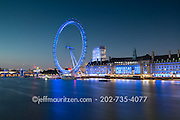 London Eye along the River Thames at twilight in London, England.