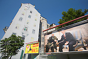 """A provocative billboard is on display on Vienna's busy Wienzeile, showing a photocomposition of U.S. President George W. Bush and Osama Bin Laden sitting together smiling and shaking hands, presumably at the White House..It is an advertising teaser for Austria's largest boulevard newspaper Kronenzeitung (or short """"Krone""""), to be completed with the phrase """"Glauben Sie es erst, wenn es in der Krone steht (only start to believe it if it stand in the Krone)."""