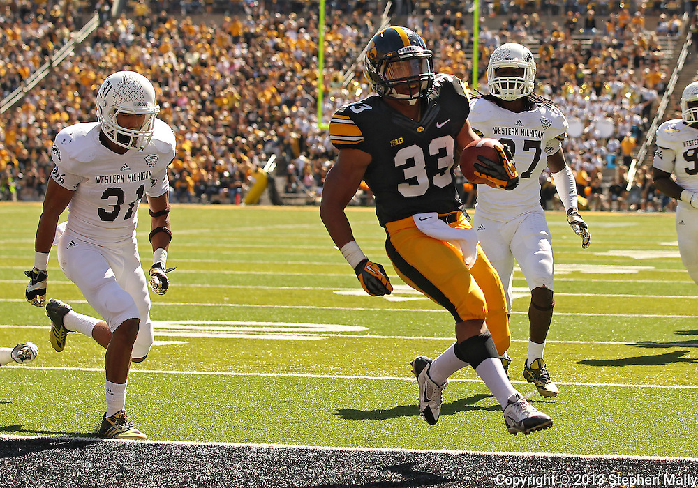 September 21 2013: Iowa Hawkeyes running back Jordan Canzeri (33) runs 16 yards for a touchdown during the fourth quarter of the NCAA football game between the Western Michigan Broncos and the Iowa Hawkeyes at Kinnick Stadium in Iowa City, Iowa on September 21, 2013. Iowa defeated Western Michigan 59-3.