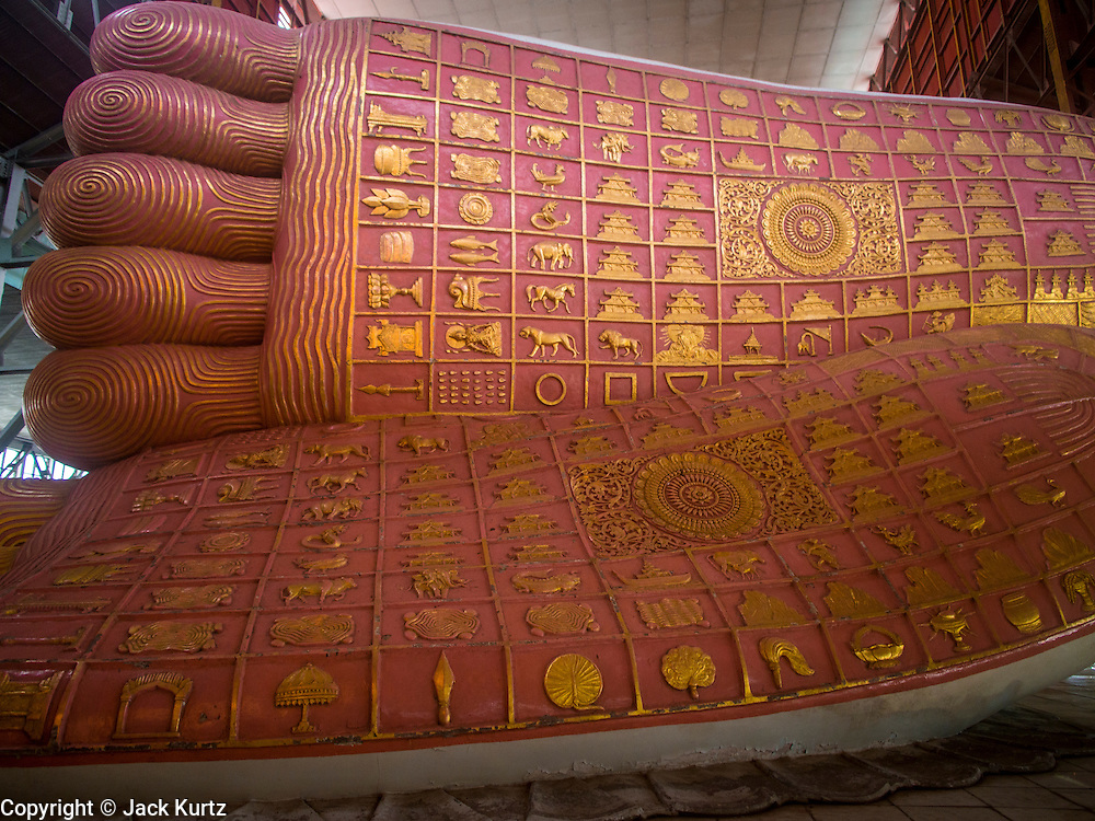 05 JUNE 2014 - YANGON, YANGON REGION, MYANMAR: The feet of the reclining Buddha in Chauktatgyi Paya (Pagoda) in Yangon, Myanmar (Rangoon, Burma). Yangon, with a population of over five million, continues to be the country's largest city and the most important commercial center.     PHOTO BY JACK KURTZ