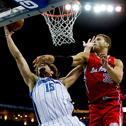 Mar 27, 2013; New Orleans, LA, USA; New Orleans Hornets center Robin Lopez (15) shoots over Los Angeles Clippers power forward Blake Griffin (32) during the first quarter of a game at the New Orleans Arena. Mandatory Credit: Derick E. Hingle-USA TODAY Sports