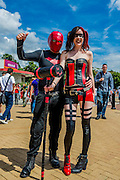 Couple Jason De St Croix, 29, and Tash Thomas, 25 both from Wales, play Red Hood and Harlequin both from Batman Comics. London Film and Comic Con 2014, (LFCC), at Earls Court, London, UK.
