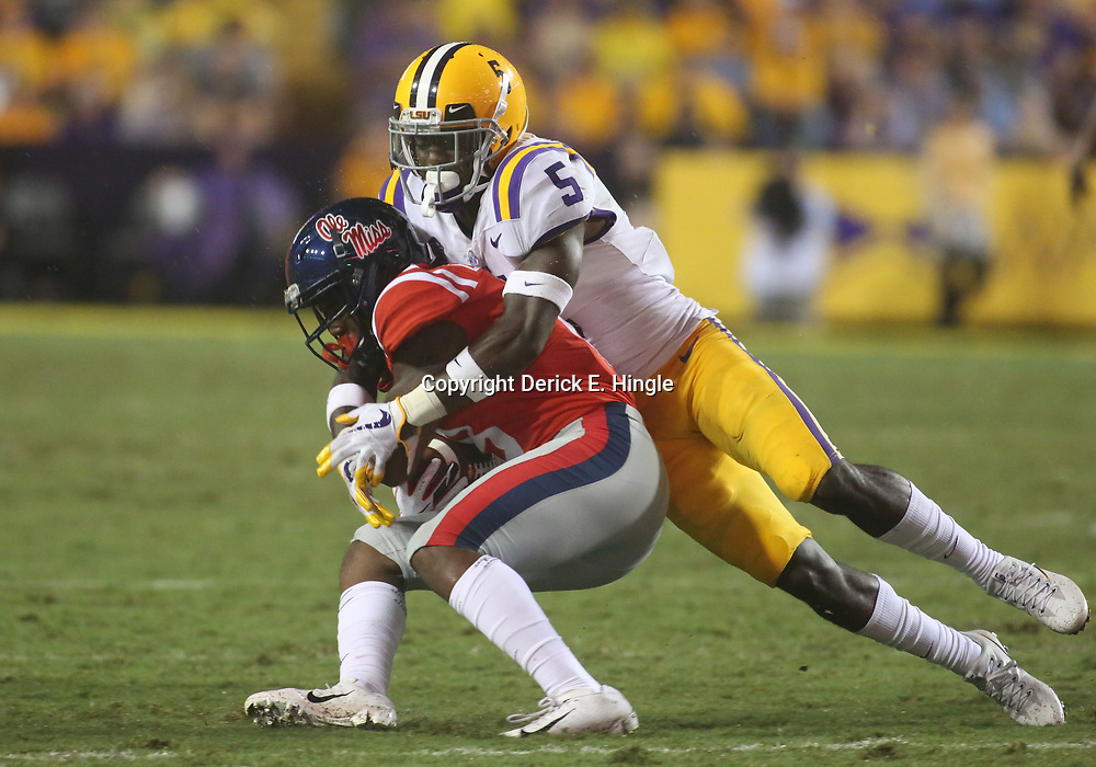 Sep 29, 2018; Baton Rouge, LA, USA; LSU Tigers cornerback Kary Vincent Jr. (5) tackles Mississippi Rebels wide receiver Elijah Moore (8) during the second half of a game at Tiger Stadium. Mandatory Credit: Derick E. Hingle-USA TODAY Sports