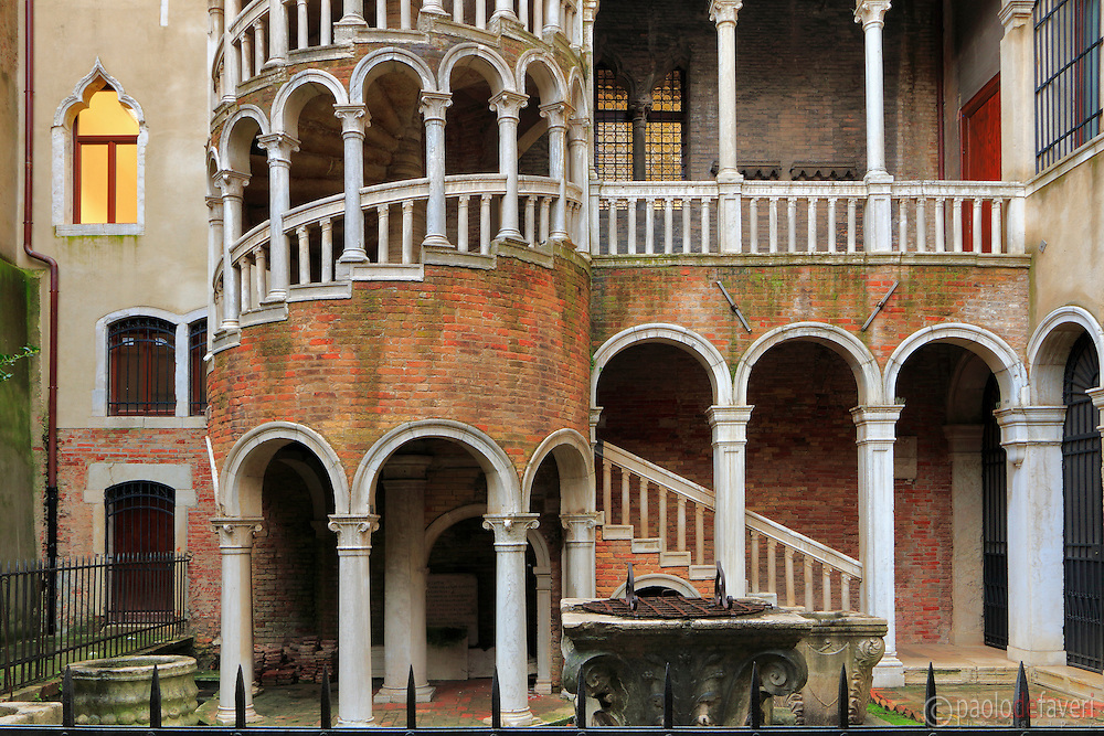 The famous &quot;Scalinata del Bovolo&quot; (staircase) at &quot;Palazzo Contarini del Bovolo in Venice, Italy. The external multi-arch spiral staircase is known as the Scala Contarini del Bovolo (literally, &quot;of the snail&quot;). <br /> The staircase leads to an arcade, providing an impressive view of the city roof-tops.