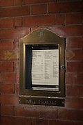 "Henley, Oxfordshire. England General View; ""The Red Lion""  the days menu displayed in an ornate brass frame, by the main entrance in Hart Street Thursday  01/12/2016<br /> © Peter SPURRIER<br /> LEICA CAMERA AG  LEICA Q (Typ 116)  f1.7  1/16000sec  35mm  7.9MB"