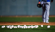 Baseballs lay in the infield during a spring training workout at the team's training facility on Friday, February 17, 2017 in Surprise, Arizona. (Ashley Landis/The Dallas Morning News)