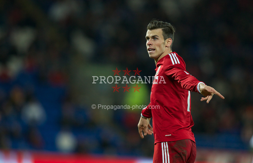 CARDIFF, WALES - Saturday, November 16, 2013: Wales' Gareth Bale gestures during an International Friendly match against Finland at the Cardiff City Stadium. (Pic by Kieran McManus/Propaganda)