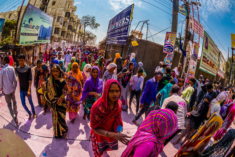 Massive crowds celebrating Holi (festival of colors), Vrindavan, near Mathura, Uttar Pradesh, India.