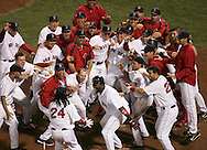 Boston's Manny Ramirez is welcomed home by teammates after hitting a walk-off, three-run home run in the bottom of ninth inning to defeat the Angels 6-3 in Game 2 of the 2007 American League Division Series Friday.