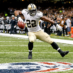 Aug 16, 2013; New Orleans, LA, USA; New Orleans Saints running back Mark Ingram (22) celebrates after scoring a touchdown against the Oakland Raiders during the first quarter of a preseason game at the Mercedes-Benz Superdome. Mandatory Credit: Derick E. Hingle-USA TODAY Sports