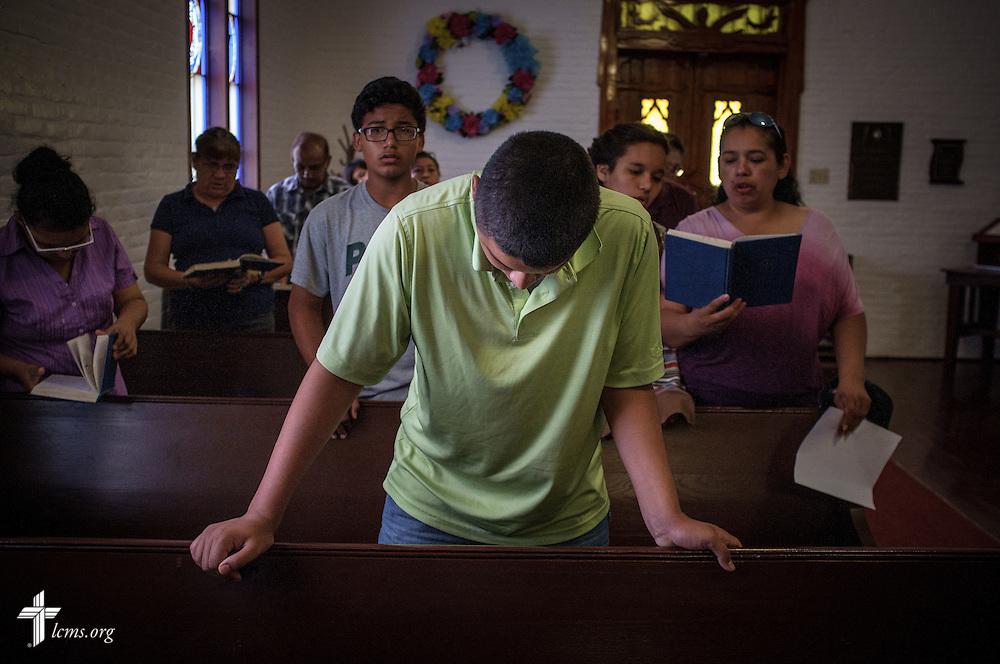 Daniel Garcia bows his head during worship at El Calvario Lutheran Church on Sunday, April 17, 2016, in Brownsville, Texas. LCMS Communications/Erik M. Lunsford