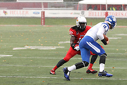 31 October 2015:  With the rain streaming down, Davontae Harris(10) looks to stop the run after reception of Robert Tonyan Jr.(18) during the NCAA FCS Football between Indiana State Sycamores and Illinois State Redbirds at Hancock Stadium in Normal IL (Photo by Alan Look)