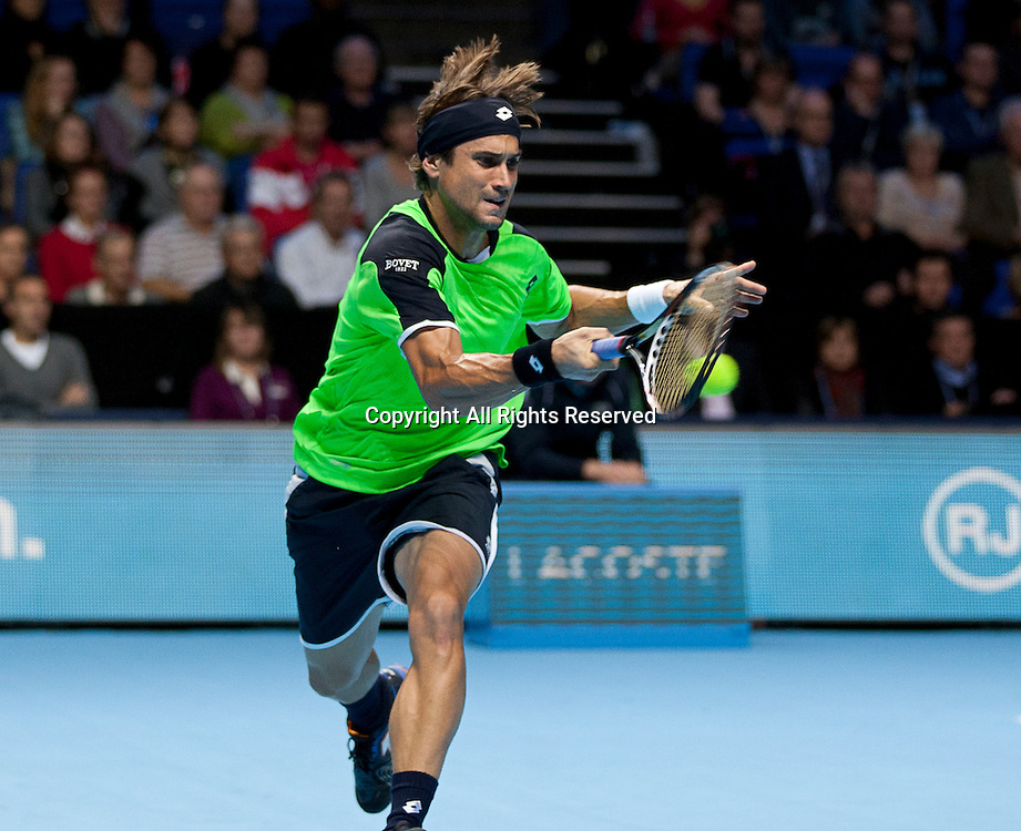 08.11.2012 London, England.  David Ferrer (ESP) in action against Roger Federer (SUI) during the Barclays ATP World Tour Finals from the 02 Arena.