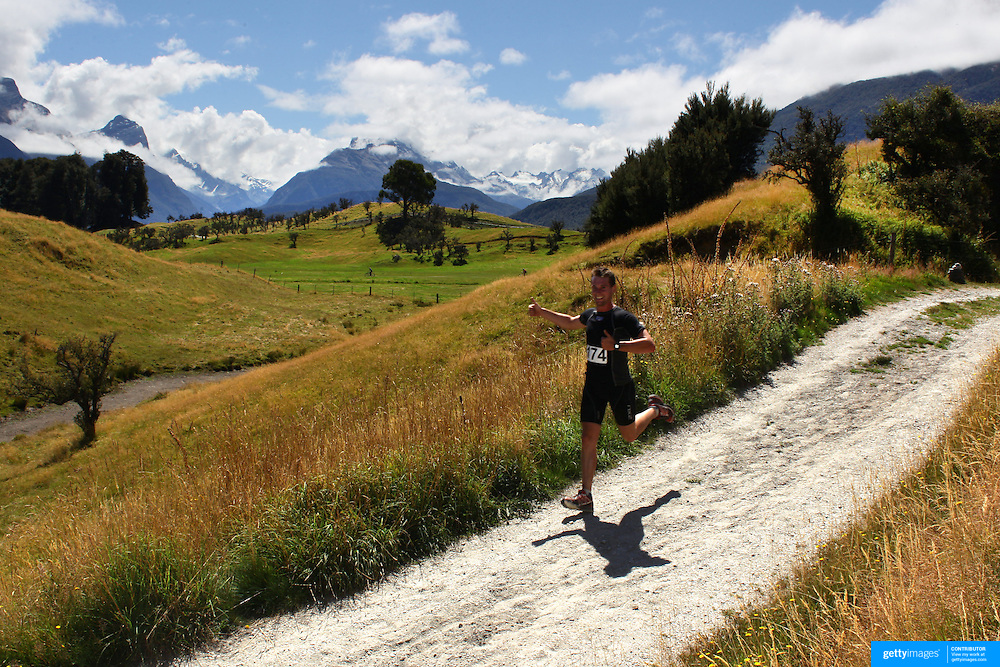 Will Bowman in action during the run leg of the Paradise Triathlon and Duathlon series with breathtaking views of Mount Aspiring National Park, Paradise, Glenorchy, South Island, New Zealand. 18th February 2012. Photo Tim Clayton