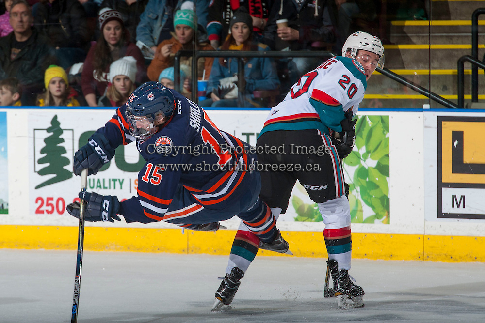 KELOWNA, CANADA - JANUARY 7: Conner Bruggen-Cate #20 of the Kelowna Rockets checks Collin Shirley #15 of the Kamloops Blazers on January 7, 2017 at Prospera Place in Kelowna, British Columbia, Canada.  (Photo by Marissa Baecker/Shoot the Breeze)  *** Local Caption ***