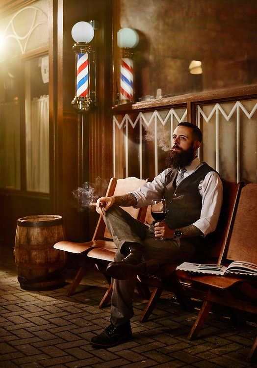 Barber and cigar shop owner sitting outside his shop shot on a PhaseOne IQ180 as a Environmental Portrait.
