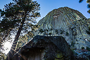 Devils Tower National Monument. Bear Lodge Mountains, Black Hills, Wyoming, USA. Devils Tower is a butte of intrusive igneous rock exposed by erosion in the Bear Lodge Mountains, part of the Black Hills, near Hulett and Sundance in Crook County. Devils Tower (aka Bear Lodge Butte) rises dramatically 1267 feet above the Belle Fourche River, standing 867 feet from base to summit, at 5112 feet above sea level. Devils Tower was the first United States National Monument, established on September 24, 1906 by President Theodore Roosevelt.