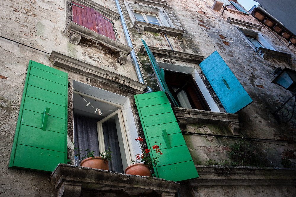 Several colorful window panes from the city of Rovinj, in Istria
