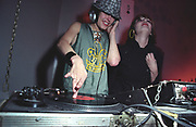 Female DJ's, Queens of Noize, one mixing, UK 2000's