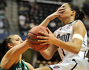 UConn's Bria Hartley takes a finger to the eye from Notre Dame's Becca Bruszewski in NCAA national semi-final action Sunday, April 3, 2011 at Conseco Fieldhouse in Indianapolis. UConn lost 72-63 to end their season. (Sean D. Elliot/The Day)
