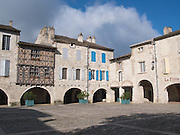 The Place des Cornieres in Lauzerte is the centre of this ancient hilltop village in the South of France. The village has often been voted as one of the most beautiful villages in France and commands a strategic and spectacular position atop a limestone peak.